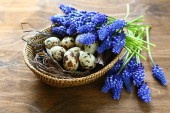 Easter eggs with flowers in a basket — Stock Photo