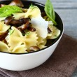 Farfalle pasta with mushrooms in a bowl — Stock Photo #57962381