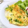 Omelette with herbs on plate — Stock Photo #58131317