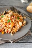 Tasty rice with vegetables on a plate — Stockfoto