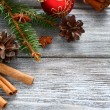 Pine branches with Christmas decorations on the boards — Stock Photo #58656489