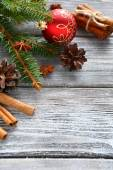 Pine branches with Christmas decorations on the boards — Stock Photo
