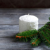 Candle with pine branch — Stock Photo