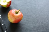 Delicious apples on a slate background — Stock Photo