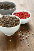 Peppercorns assorted in bowls — Stock Photo
