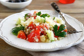 Salad with arabic couscous and vegetables on a white plate — Stock Photo