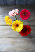 Bouquet of gerberas on the boards — Foto de Stock