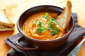 Nutritious pumpkin soup with parsley and bread — Stock Photo