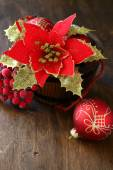 Christmas flower and balls on plywood — Stock Photo