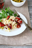 Rice with sun-dried tomatoes in a plate — Stock Photo