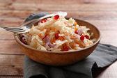 Sauerkraut with onion in bowl — Stock Photo