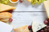 Assorted cheese on the boards — Stock Photo