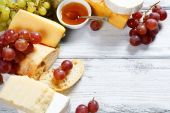 Various types cheese on a background of boards — Stock Photo