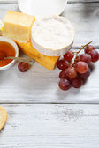 Delicious cheeses on the boards — Stock Photo