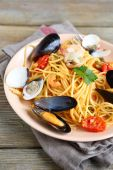 Nutritious pasta with meat mussels and squid on a plate — Stock Photo