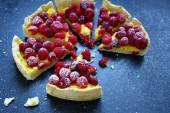 Slices of sweet tart with raspberries on slate background — Stock Photo