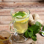 Useful ginger tea on the boards — Stock Photo