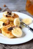 Curd pancake with chocolate and chunks banana — Stock Photo