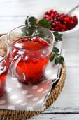 Tea made from cranberry on tray — Stock Photo