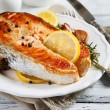 Roasted salmon steak on a plate — Stock Photo #62623059