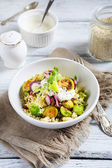 Couscous with brussels sprouts and onions — Stock Photo