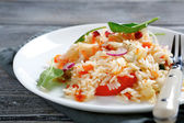 Delicious rice with onions and basil — Stock Photo
