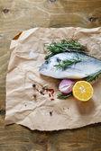 Sea bream with onion, lemon and rosemary — Stock Photo