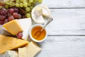 Delicious cheeses with honey — Stock Photo