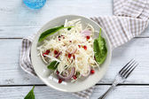 Salad with cabbage, onions and grenade — Stock Photo