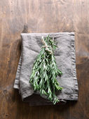 Bunch of rosemary on a napkin — Foto Stock