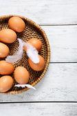 Easter eggs in basket — Stockfoto