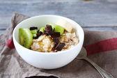 Porridge of oatmeal and fruit — Stock Photo
