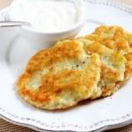 Potato pancakes with sour cream — Stock Photo #67565985