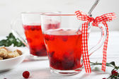 Winter cranberry tea on the boards — Stock Photo