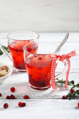 Christmas cranberry tea on the boards — Stock Photo