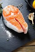 salmon on slate background — Stock Photo