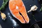 Raw Salmon on slate background — Stock Photo
