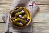 Pickles in wooden bowl — Stock Photo