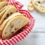 Italian bread with filling on a napkin — Stock Photo #73528609