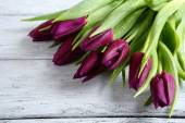 Purple tulips on the boards — Stock Photo