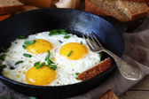 Hot fried eggs in a pan — Stock Photo