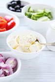 Feta and other ingredients for salad — Stock Photo
