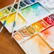 Paintbrush and paint palette — Stock Photo #64318945