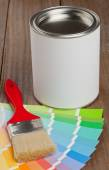 Color chart guide with brush and paint bucket — Stock Photo