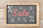 Sale chalk writing with percentage signs on chalkboard — Stock Photo