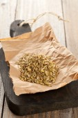 Heap of fennel seeds on kitchen board — Stock Photo