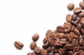 Corner decoration of coffee beans on white background — Stock Photo