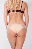 Dessous auf eine schöne blonde gebräunten Körper — Stockfoto