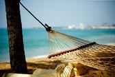 Hammock relaxation on beach and ocean — Stock Photo