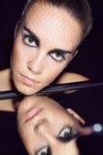 Beautiful woman wearing makeup . — Stock Photo